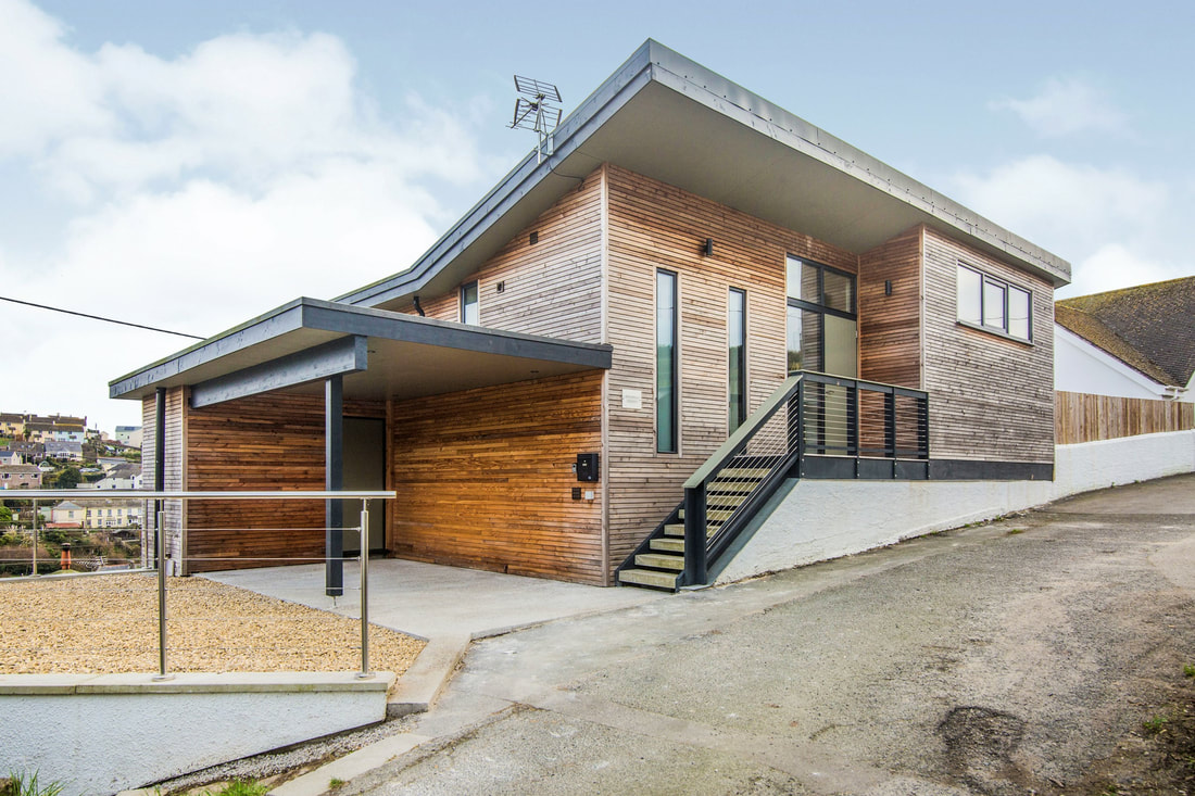Angwella House, timber clad bespoke building